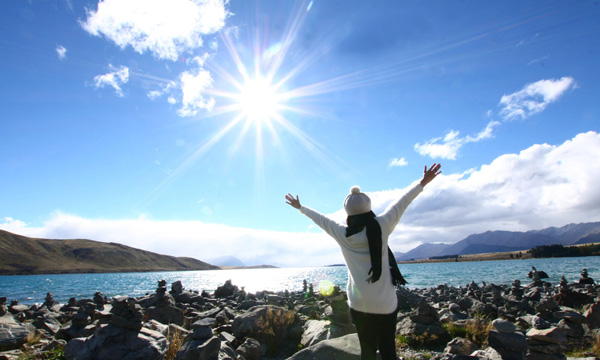 Woman with outstretched arms on the clear day image.