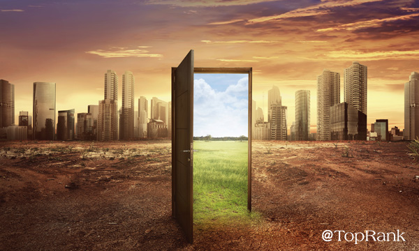 Doorway open to green pastures within an urban cityscape image.
