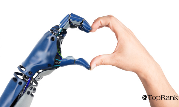 Robot and human hands forming a heart image.