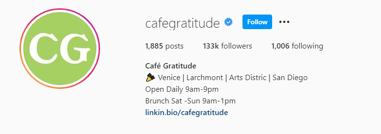 Instagram bio for Cafe Gratitude with business info separated by vertical lines